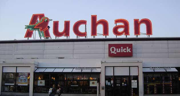 Auchan gèle ses investissements face à la guerre des prix